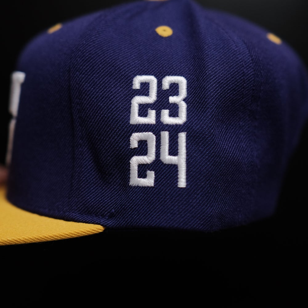 1 OF 1. Protect the Legacy in White on Purple