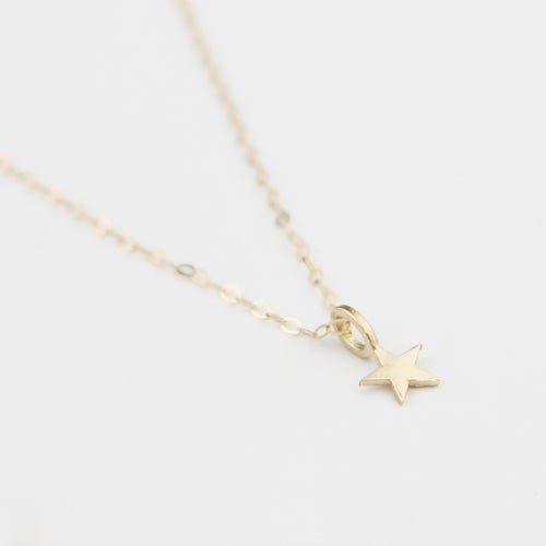 Image of 9ct gold teeny star necklace