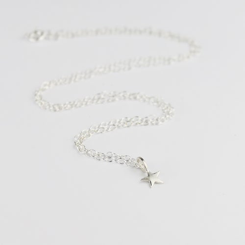 Image of Teeny silver star necklace