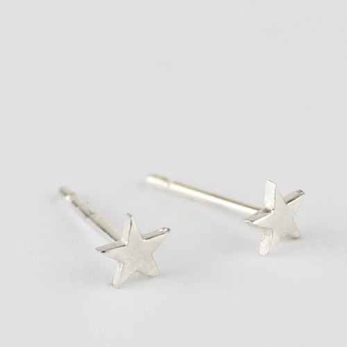 Image of Teeny silver star studs