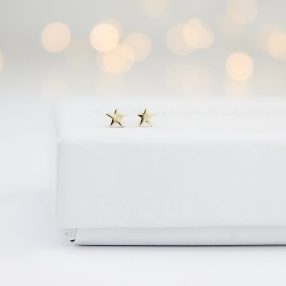Image of Teeny gold star stud earrings
