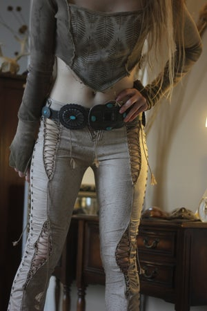 Image of THE PILGRIM STUDDED SNAKE LACE UP BOOTCUT PANTS