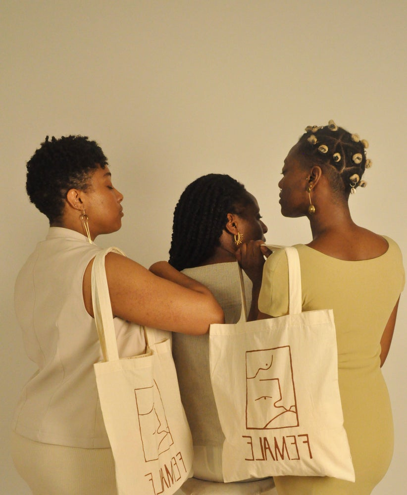Image of female tote
