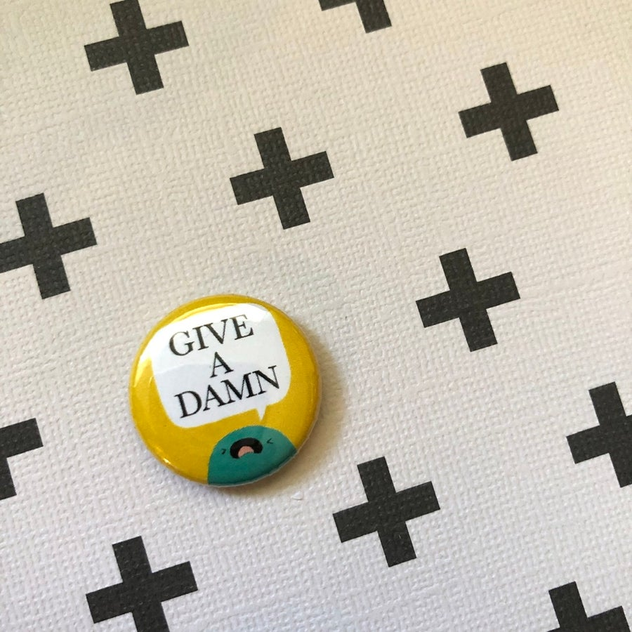 "Image of GIVE A DAMN 1"" buttons"