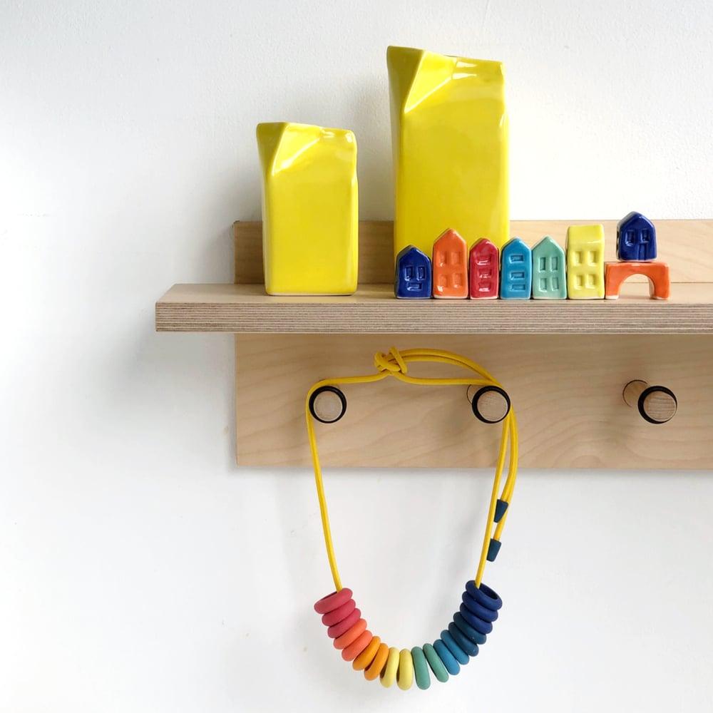 Image of Yellow Milk Jug
