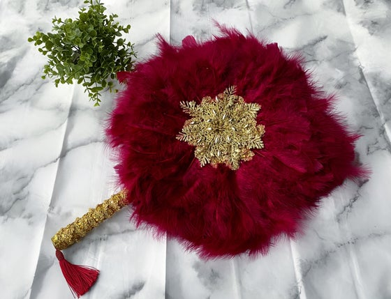 Image of Fuchsia pink and gold hand fan