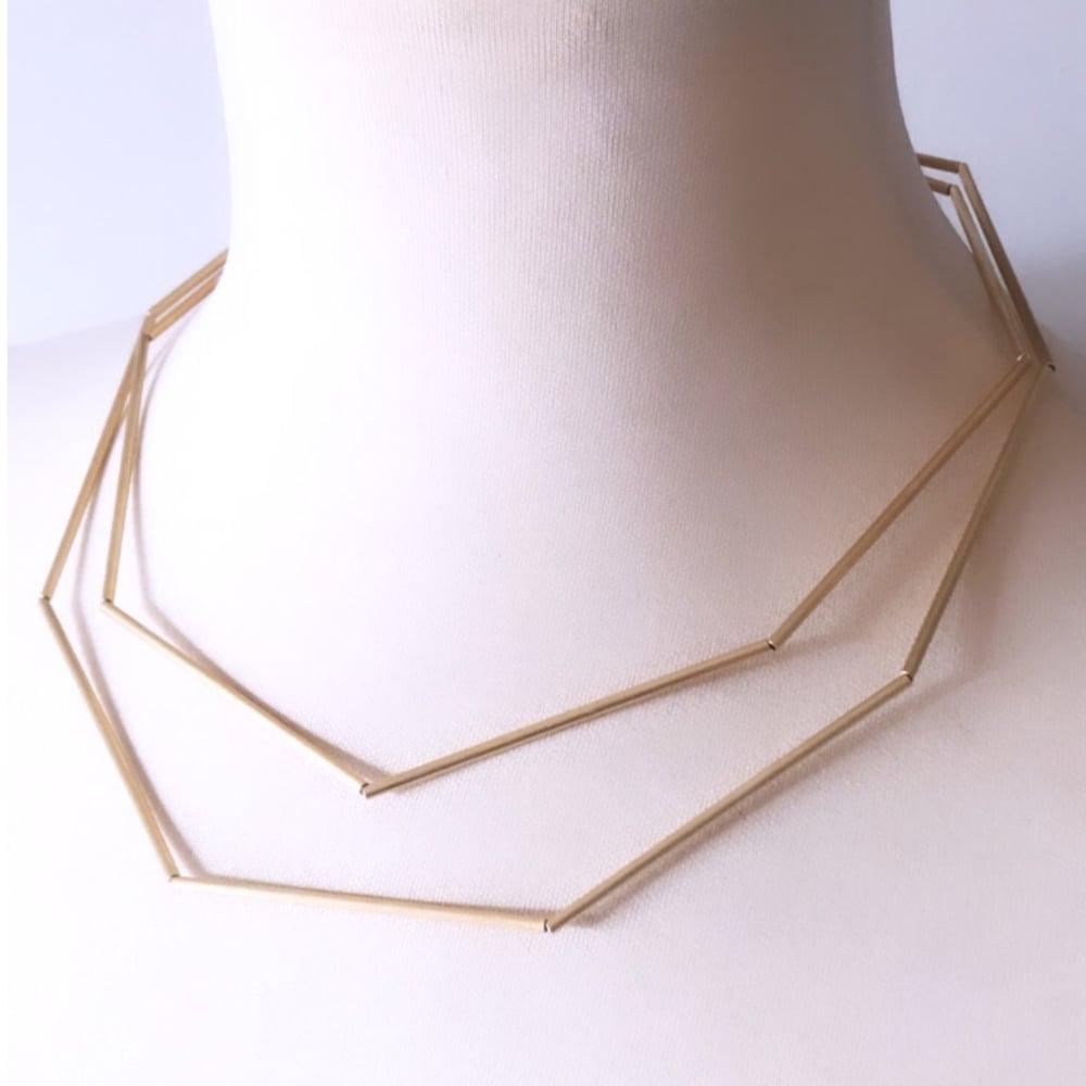 Image of Collaret geomètric or 2 voltes. Collar geométrico oro 2 .