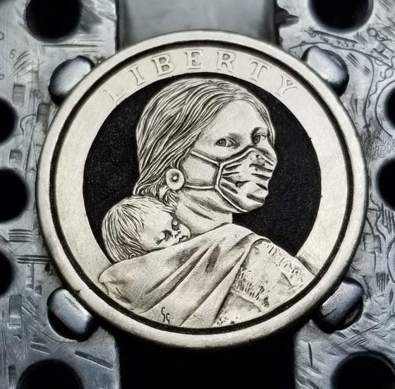 Image of Carved Masked Sacagawea dollar