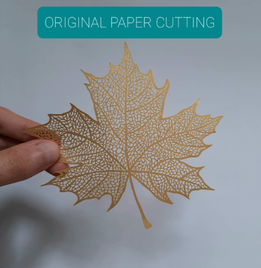 Image of Gold Foil Print of Leaf Paper Cutting