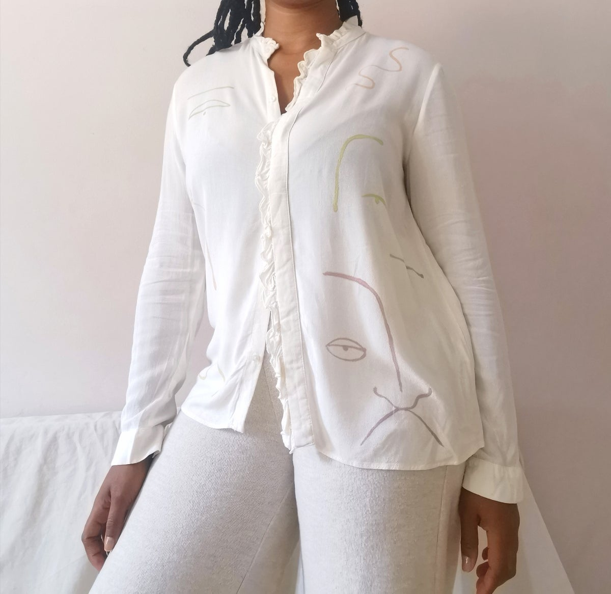 Image of muted pastel blouse