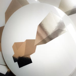 Image of round mirror on white