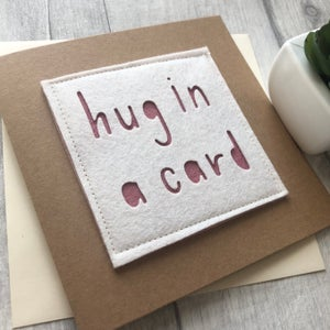 Image of Hug in a card