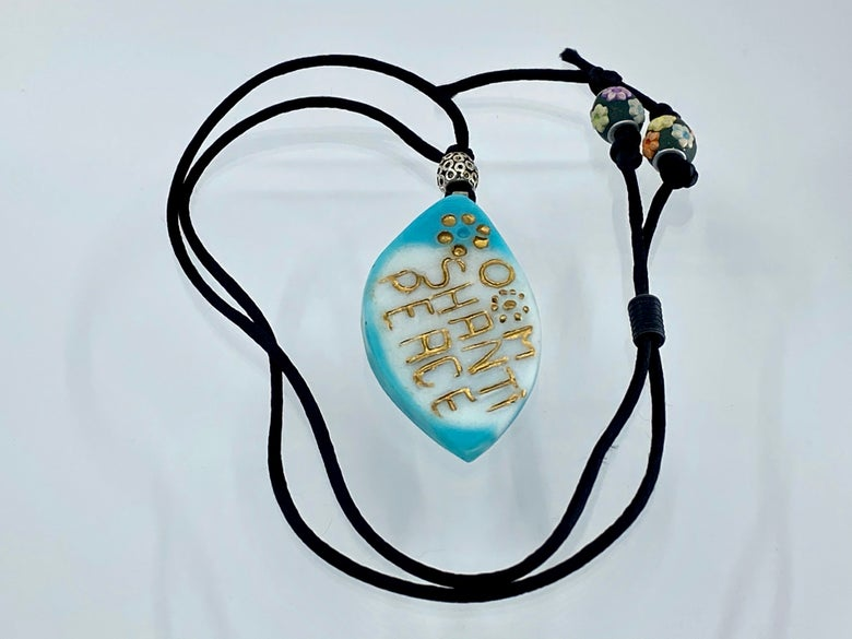 """Image of Pate de Verre Glass """"OM Shanti Peace"""" Lotus Petal Shaped Pendant in Turquoise and White"""