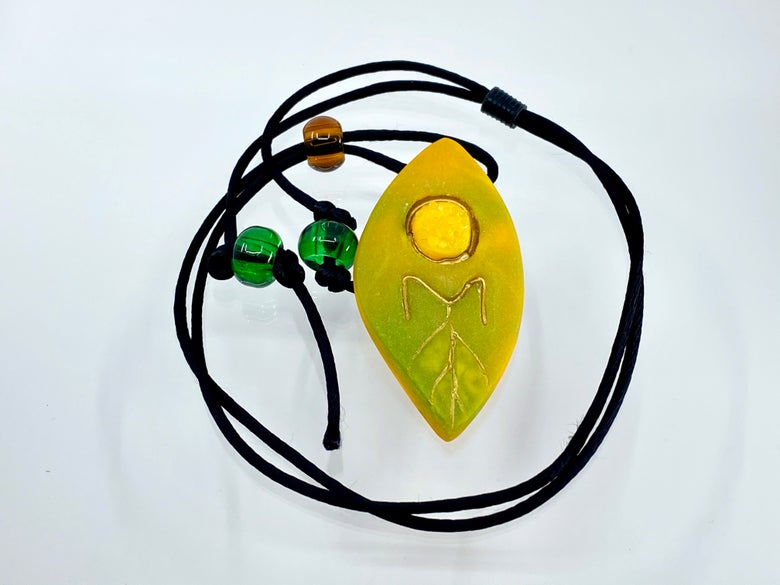 """Image of Pate de Verre Glass """"OM"""" Lotus Petal Shaped Pendant in Yellows and Greens"""