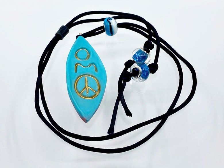 "Image of Pate de Verre Glass ""OM Peace"" Lotus Petal Shaped Pendant in Turquoise"