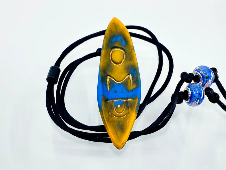 """Image of Pate de Verre Glass """"OM"""" Lotus Petal Shaped Pendant with Third Eye in Blue and Yellow"""