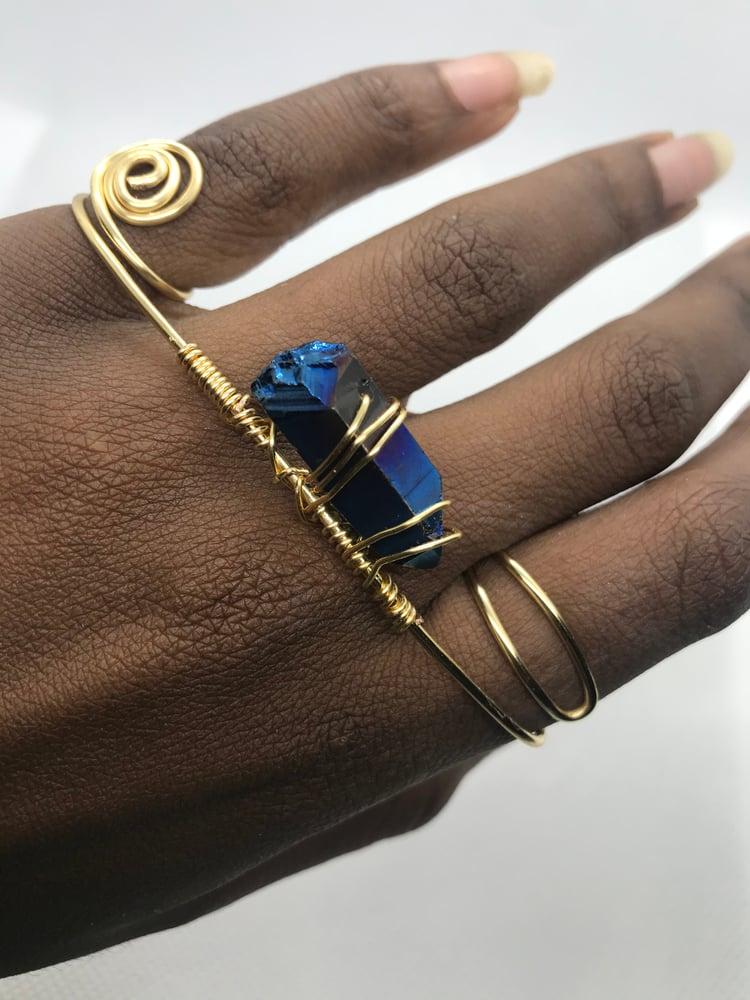 Image of Sleek blue 4 finger ring