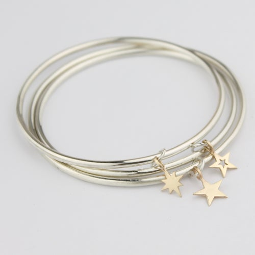 Image of Set of three star bangles in silver and 9ct gold