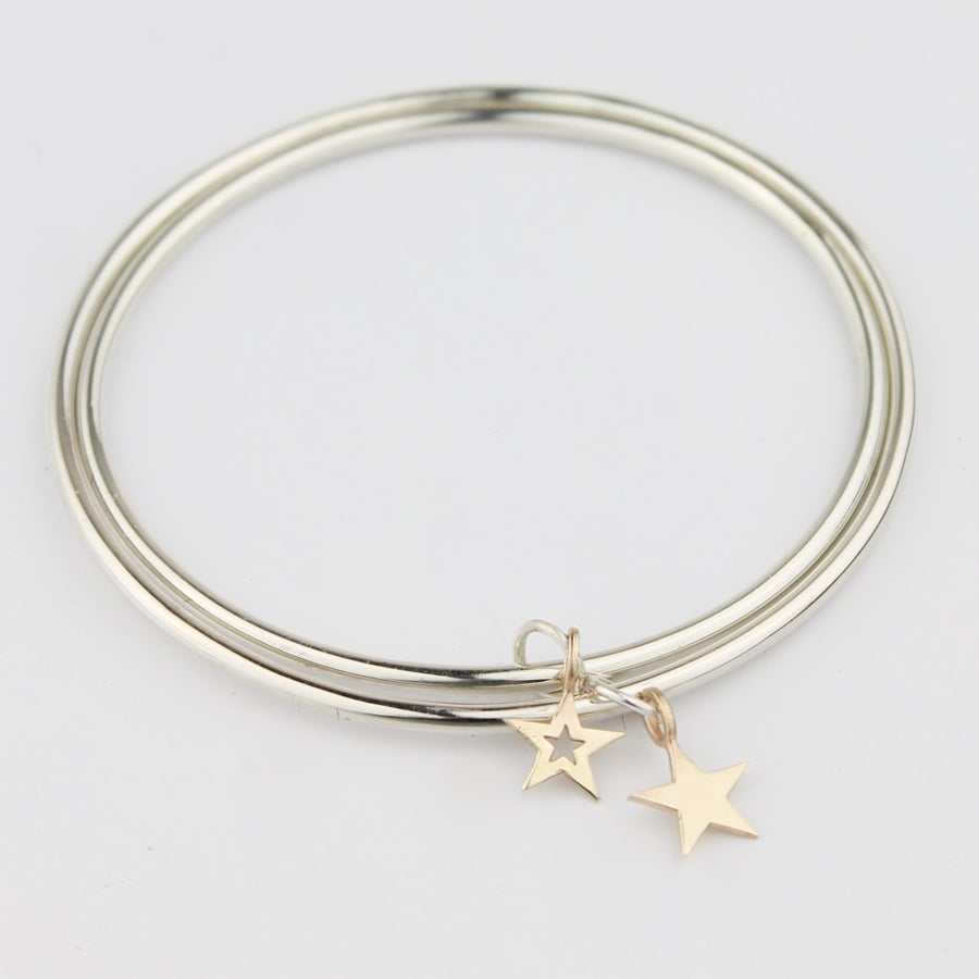 Image of Set of two star bangles in silver and 9ct gold