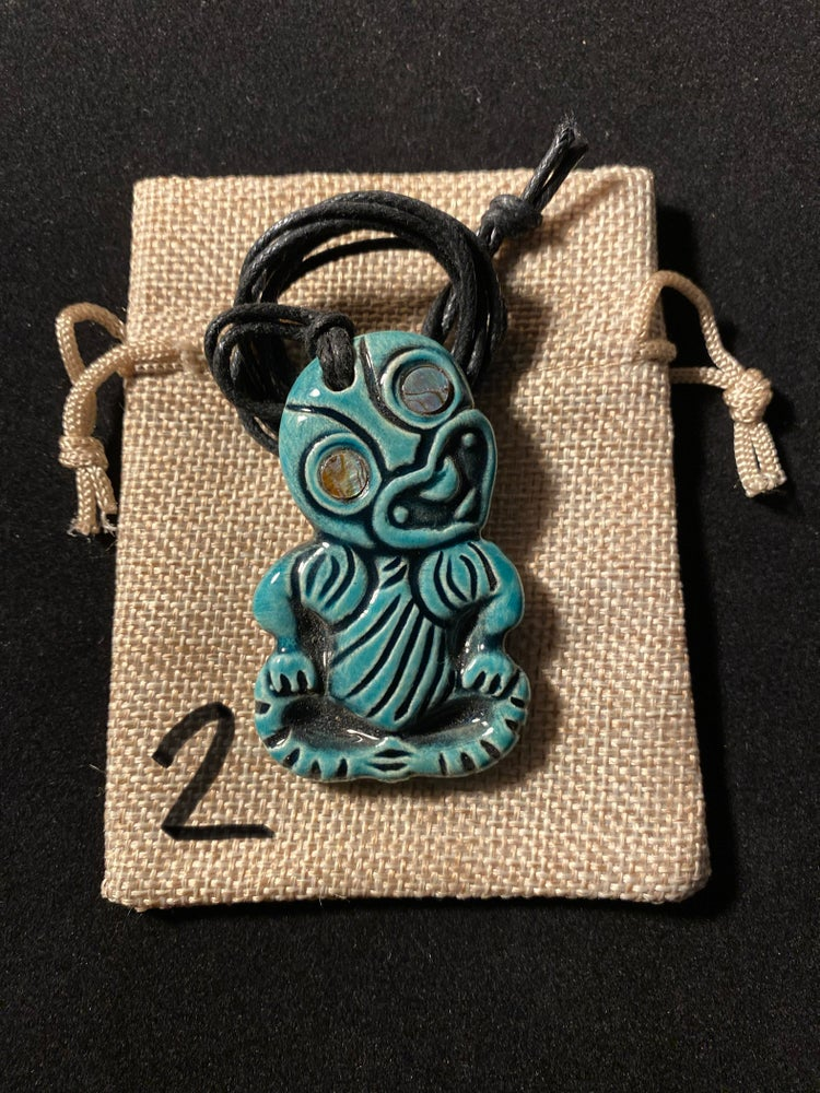 Image of Assorted Hei'hei Ceramic Tiki Pendants With Abelone Shell Eyes (Continued)