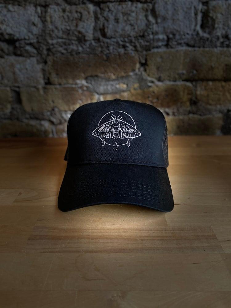 Image of Weeping Moth Trucker Hat