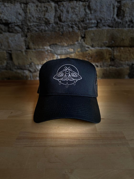 Image of Weeping Moth Trucker Hat