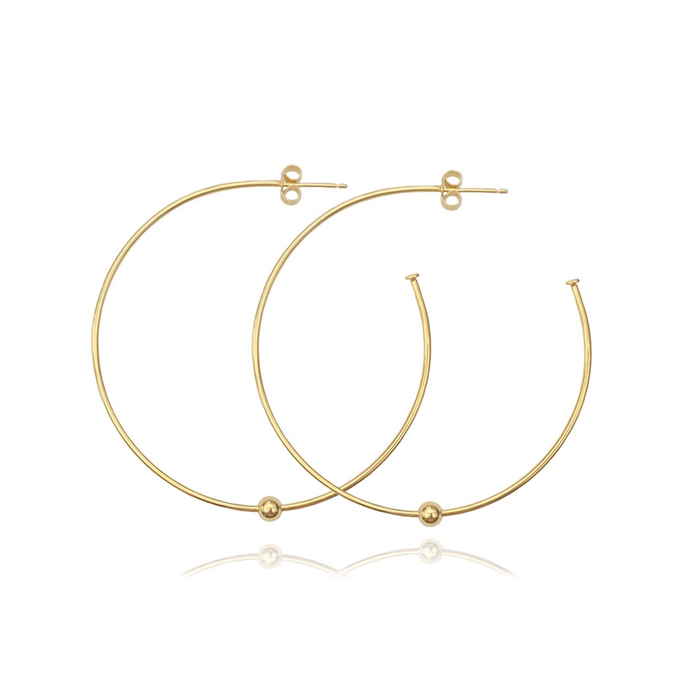 Image of Large gold hoops with a single bead