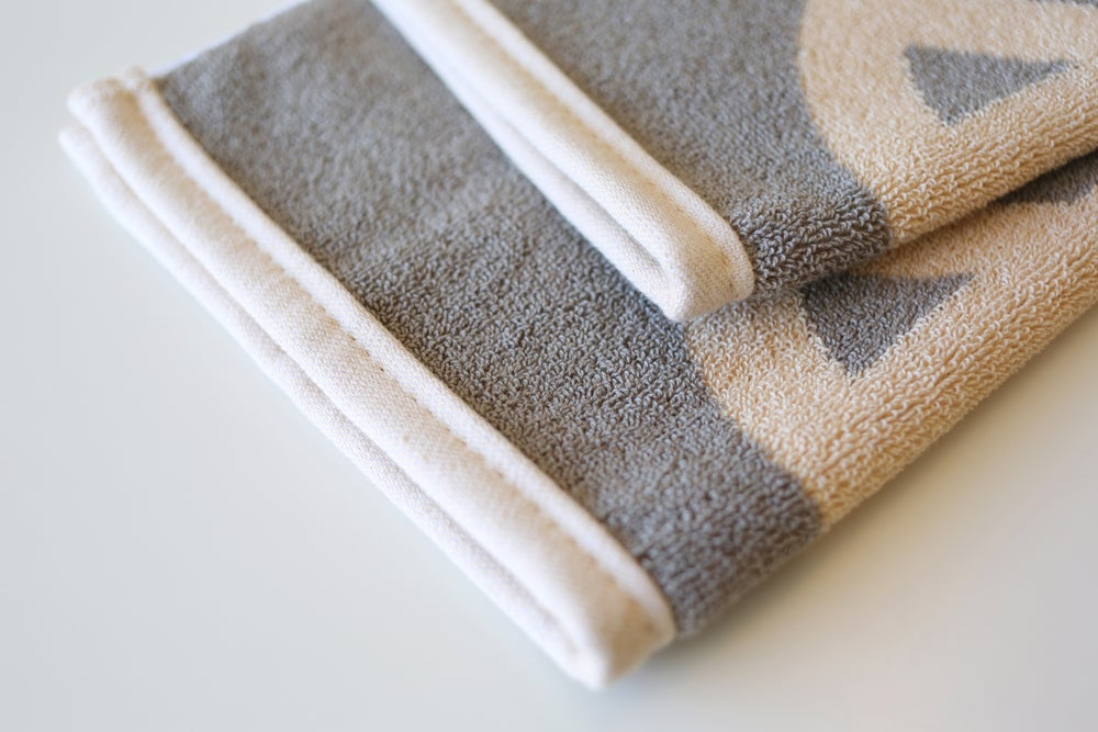 Image of TINY PEACE Hand Towel <div> Cream & Champagne </div>