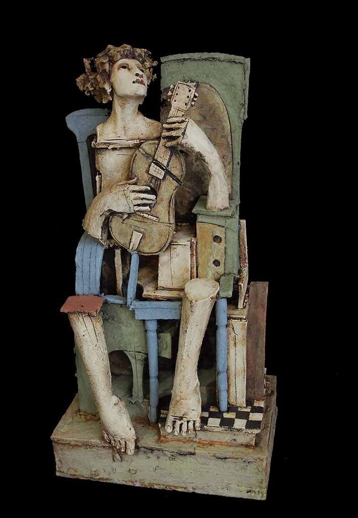 Image of CHRISTY KEENEY - GUITAR PLAYER CERAMIC SCULPTURE