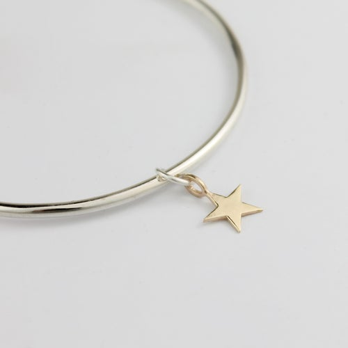 Image of Handmade silver bangle with 9ct gold five pointed star