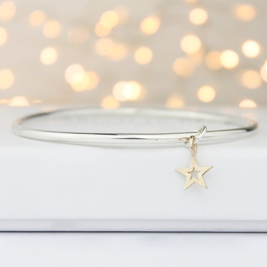 Image of Handmade silver bangle with 9ct gold star with cutout