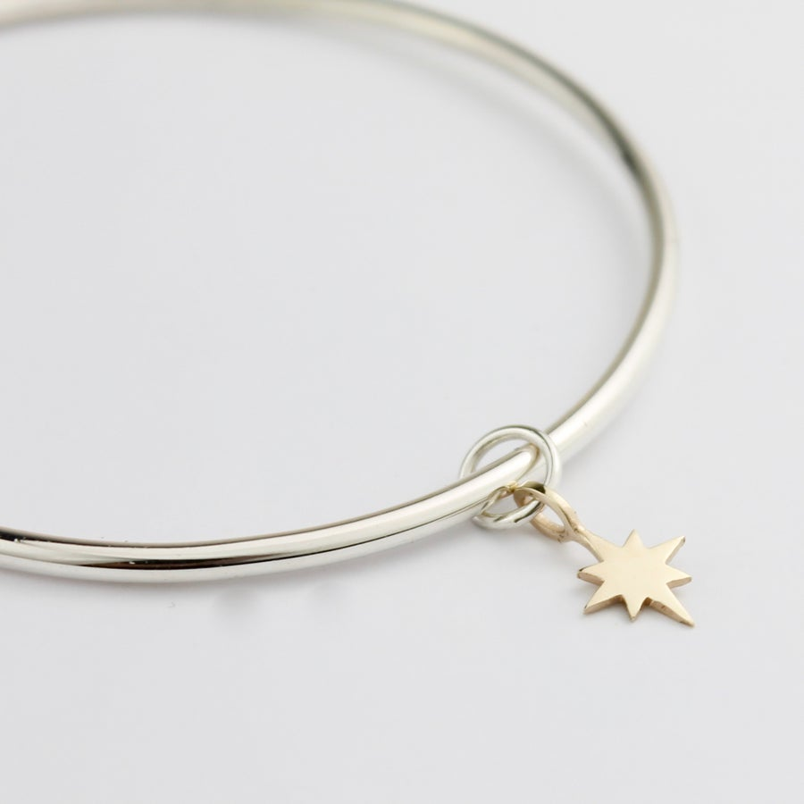 Image of Handmade silver bangle with 9ct yellow gold eight pointed star