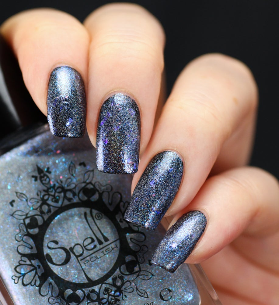 "Image of ~Charlie's Footprints~ icy blue holo flakie shimmer ""Charlie Loves Bella"" Spell Polish!"