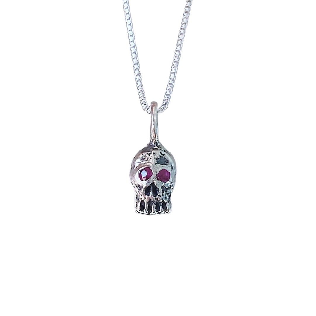 Image of tiny *sparkly* skull necklace