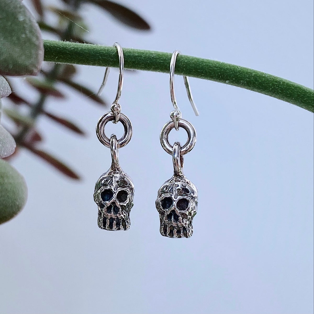 Image of white sapphire skull earrings