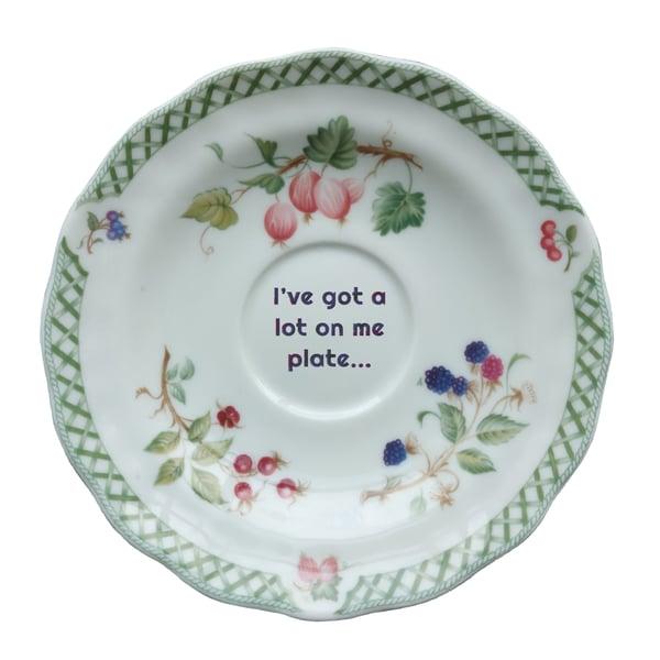 Image of I've got a lot on me plate... (ref. 61)