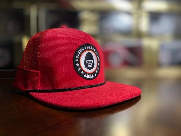 Image of Defend Black Life Trucker Hat