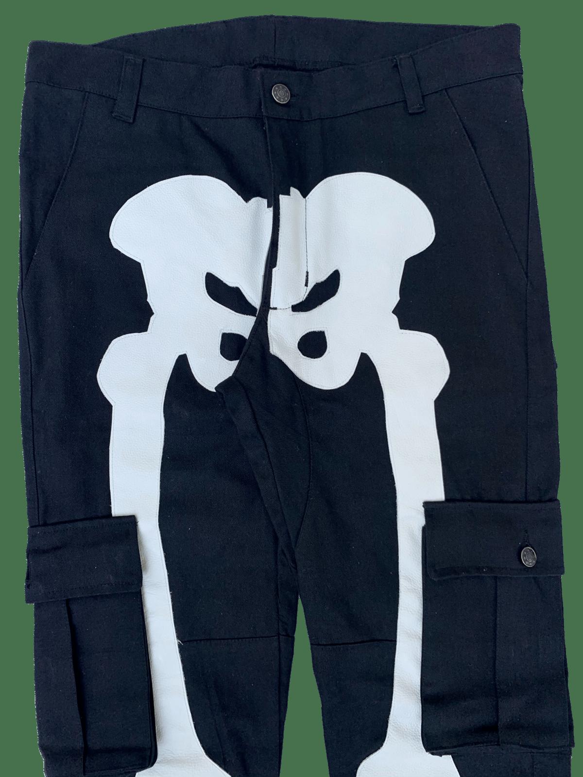 Image of BLACK SNAP CARGO BONE PANTS