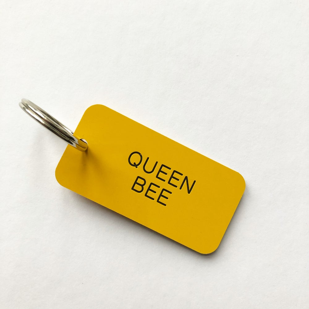 Image of QUEEN BEE LOCKER KEYRING IN YELLOW + BLACK