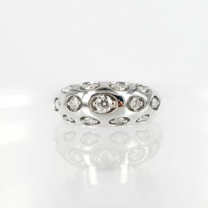 Image of 14ct white gold domed diamond set cocktail ring.      pj5458