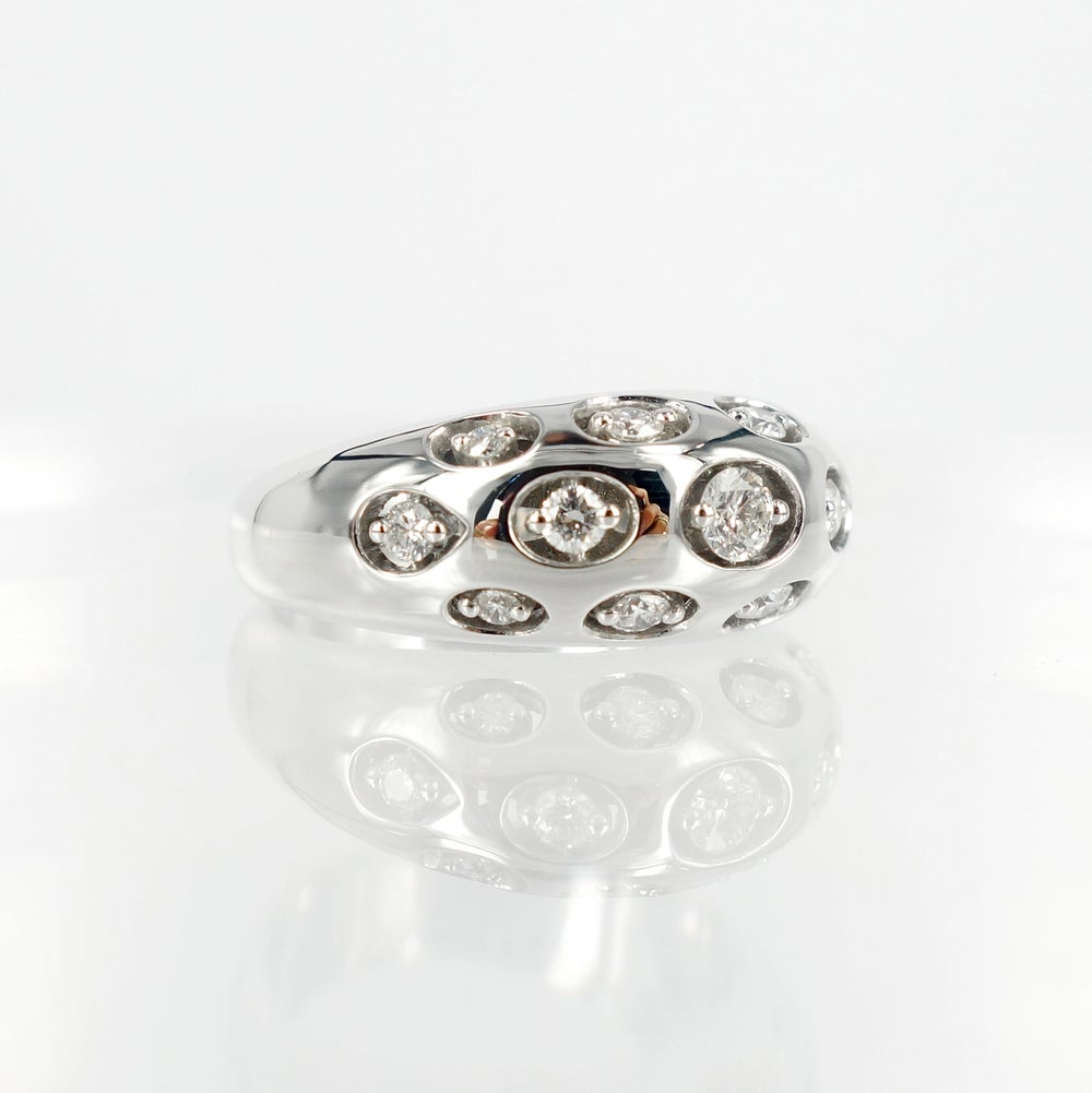 Image of 14ct white gold domed diamond set cocktail ring.      pj5458