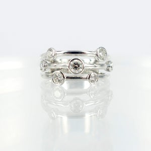 Image of White gold and diamond dress ring. Pj5661