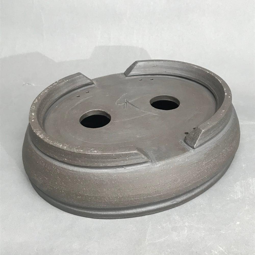 Image of 308 Unglazed Dark Oval