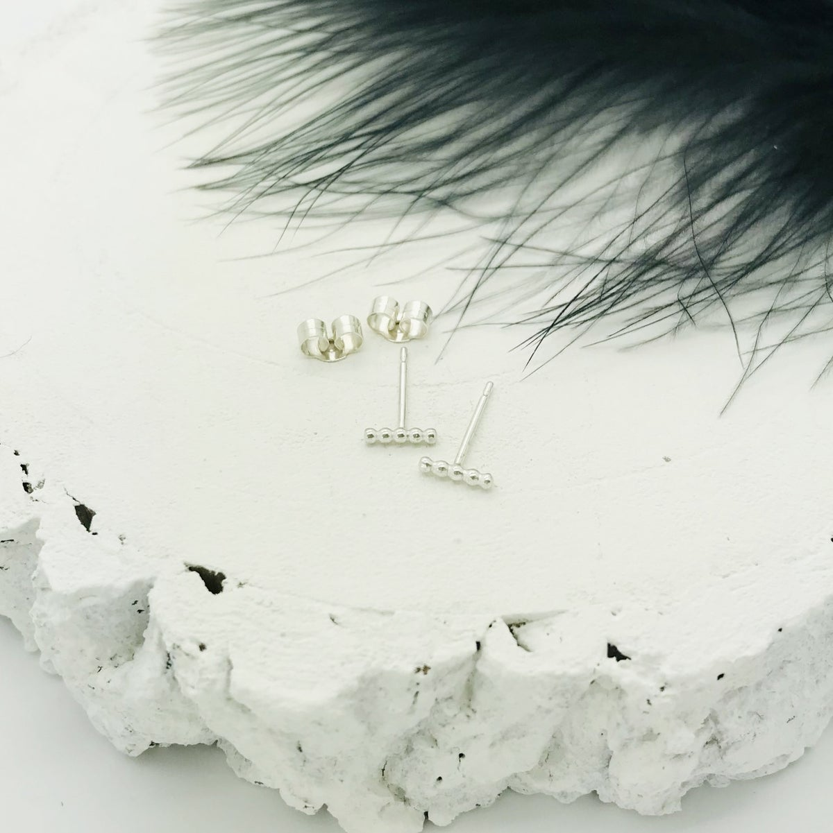 Image of Silver beaded bar studs