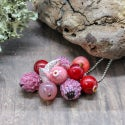 Lampwork pendant with clover and cranberry