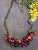 Lampwork necklace with wild blueberry and raspberry