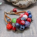 Lampwork bracelet with goose berry and raspberry
