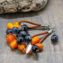 Lampwork bracelet with cloudberry and blueberry