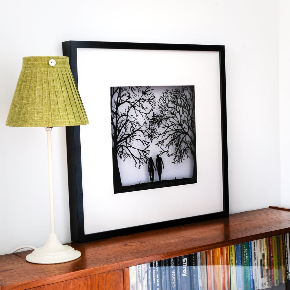 Image of Framed Papercut Picture of a Couple Walking in the Forest
