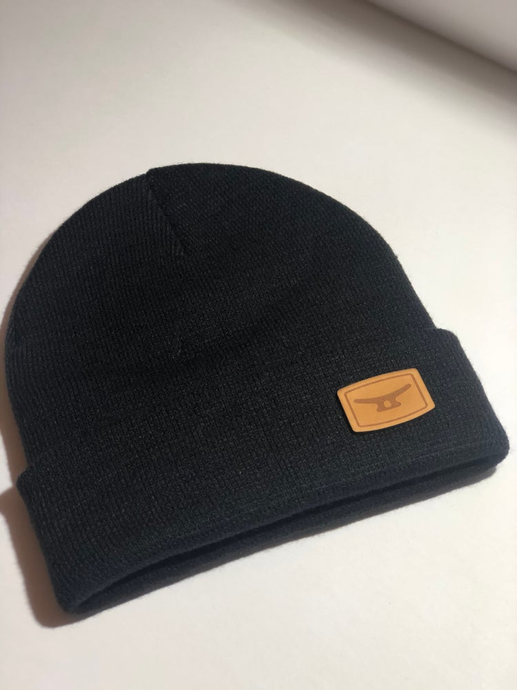 Image of MTD premium Knit beanie, folded w/ authentic brown leather patch